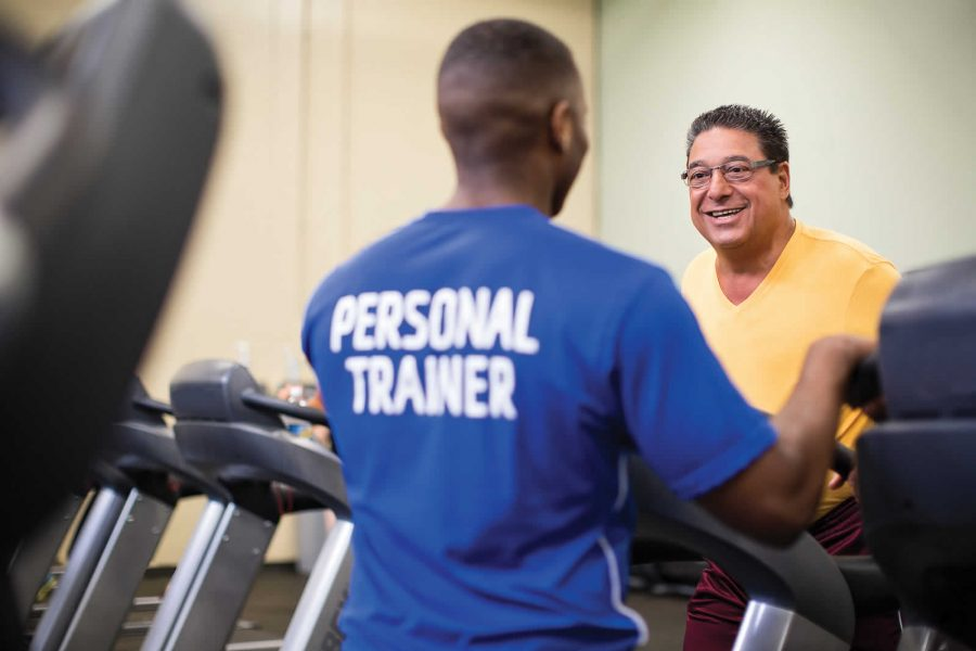 How does a trainer help in losing weight?